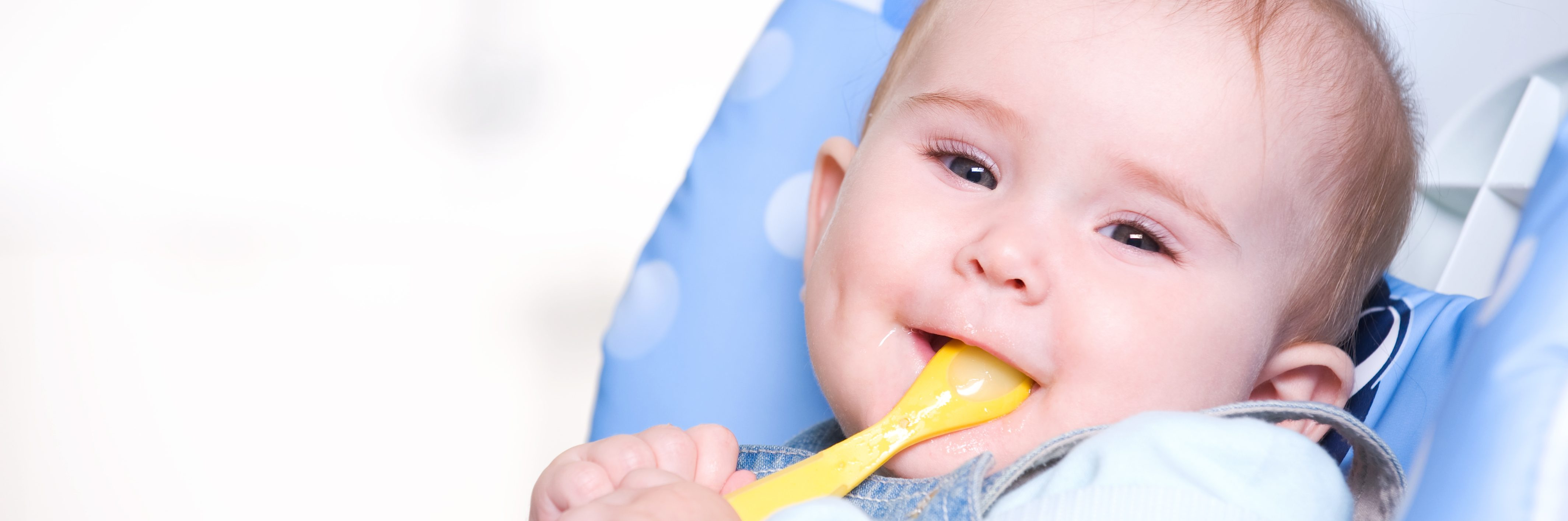 Baby With Spoon In Mouth